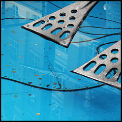 suspense (foto.phrend) Tags: blue sculpture abstract london water silver square coins circles 500d 2013