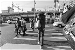 Crossing with Kome and Roger (Eric Flexyourhead (Onoharahigashi, Minoh-shi)) Tags: street city ladies friends sky people urban bw japan walking japanese blackwhite women crossing photographers clear kobe lensflare  roger kansai hyogo sannomiya chuoku  kome    kobeshi  panasoniclumix714mmf40 olympusem5