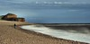 Budleigh Slo-Mo (Gary Baldy) Tags: sea blur beach person waves pentax pebbles k20d hoyandx400 sigma18250mmacro