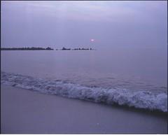 (bensn) Tags: sunset sea sun mamiya film beach japan evening wave niigata f4 80mm fujipro400h 7ii