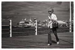 on her way to punda (Gerard Koopen) Tags: street people bw woman netherlands 35mm fuji streetphotography fujifilm willemstad netherlandsantilles streetshot punda nederlandseantillen straatfotografie 2013 xpro1 pontonbridge