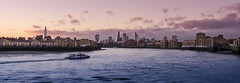 Canary Wharf Sunset (CarolynEaton) Tags: sunset panorama london ferry thames skyline nikon cityscape dusk capital panoramic canarywharf shard gherkin cityskyline nikkor18200mm thamesclipper nikond7000 vision:mountain=0825 vision:sunset=0749 vision:outdoor=099 vision:clouds=0837 vision:sky=08 vision:car=083 vision:ocean=0791