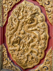 Decorative door carving with dragon motif in relief (Victor Wong (sfe-co2)) Tags: ancient animal antique architecture art asia asian beijing china chinese city craft crest culture curved decoration design detail door dragon famous forbidden golden gugong hallofsupremeharmony heritage historic history ming museum oriental ornate outdoor palace pattern qing red relief sculpture symbol taihedian temple texture traditional travel weathered wooden