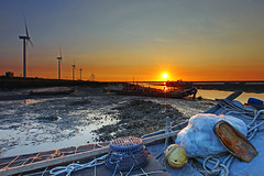 a fishing port sunset (Thunderbolt_TW) Tags: sunset sea sky sun reflection water windmill canon landscape taiwan     windturbine  changhua       hsienhsi  5d2 changpingindustryarea