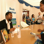 Ben Okri signing books at the 2003 Edinburgh International Book Festival