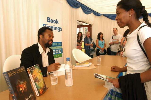 Ben Okri signing books at the 2003 Edinburgh International Book Festival