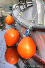 6592 Floats (Paul Rioux) Tags: reflection reflections fishing fisherman marine bc britishcolumbia victoria vancouverisland commercial fishermanswharf bouys floats jamesbay bumpers innerharbour fishboat commercialfishing prioux