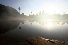 (marcwiz2012) Tags: mist reflection tree silhouette sunrise ancient ruins asia cambodia khmer angkorwat palm angkor wat historicsite