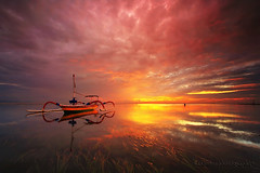 BURNING SKY (ManButur PHOTOGRAPHY) Tags: red sea sky bali cloud sun seascape reflection grass clouds sunrise canon boat scenery colorful aqua exposure glow explorer filter 7d filters 1022mm canonefs1022mmf3545usm gnd f3545 canon7d manbutur manbuturphotography