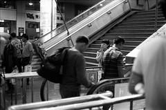 Passenger () Tags: china street leica travel portrait people film architecture lens blackwhite snapshot chinese documentary rangefinder railwaystation xian   streetfood ilford 2012 leicam7 reportage streetshot m7 ilfordfp4 carlzeiss zm csonnar nikonsupercoolscan9000ed flickraward xianrailwaystation plus125 csonnart1550 gettychinaq4
