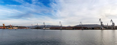 cranes in the river of bilbao, in Sestao (Mimadeo) Tags: sea panorama industry water port river harbor dock industrial harbour crane transport vessel panoramic cargo bilbao maritime wharf heavy freight loading barakaldo unloading nervion sestao