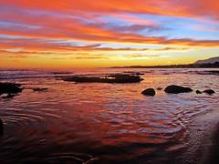 Reflejos en el mar (Antonio Chac) Tags: sunset espaa atardecer mar day cloudy andalucia nubes costadelsol puestadesol rocas marbella malga