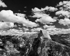 Cumulus Clouds and Half Dome, Yosemite National Park (4 Corners Photo) Tags: california sky blackandwhite mountains tree clouds forest unitedstates yosemite cumulus halfdome northamerica yosemitenationalpark geology yosemitevalley sierranevadamountains mariposacounty vision:mountain=0758 vision:sky=0614 vision:outdoor=0929 vision:clouds=0571 vision:car=054