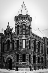 Old City Hall (TK_Haines) Tags: blackandwhite bw snow building museum architecture sandstone 1893 fortwayne greyscale romanesquerevival richardsonianromanesque roundarches thehistorycenter wingmahurinarchitecturalfirm fortwayneoldcityhallbuilding beltcourses