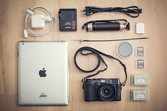 My Travel Kit (Adam Haranghy) Tags: camera new york travel 2 paris adam london bag photography fuji stockholm whats small battery fujifilm kit whatsinmybag charger reise ipad x100 reisegepäck haranghy