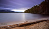 Loch Garten, Highlands (Innes Mackay Photography) Tags: longexposure blue trees light sunset sky sun seascape blur green beach water clouds landscape lights scotland highlands sand nikon rocks warm shoreline sunny wideangle blurred hills tokina shore rays loch filters hitech graduated cairngorms boatofgarten lochgarten remoteshutterrelease d7100 tokina1116mm 10stopfilter 11mm16mm leeholder