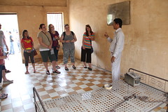 """Touring Toul Sleng - a high school turned into a torture and interrogation center by the Khmer Rouge, 1975-1979. <a style=""""margin-left:10px; font-size:0.8em;"""" href=""""http://www.flickr.com/photos/46768627@N07/13295518635/"""" target=""""_blank"""">@flickr</a>"""