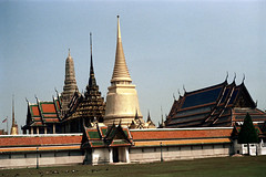 19-312 (ndpa / s. lundeen, archivist) Tags: roof color building tower film rooftop birds architecture 35mm buildings thailand temple rooftops spires bangkok stupa buddhist pigeons nick towers spire roofs tiles grandpalace thai 1970s 1972 19 1973 grounds watphrakaew templeoftheemeraldbuddha finial dewolf finials nickdewolf coloredtiles photographbynickdewolf goldenstupa reel19