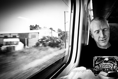 On Board Comunicado (Dave G Kelly) Tags: portrait bw man motion portugal monochrome horizontal train day phone transport communication indoors smartphone technolory