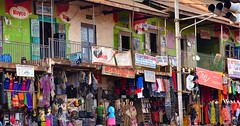 Shopping, Uganda (Rod Waddington) Tags: africa african afrika afrique uganda ugandan shop shopkeeper shopping streetphotography street advertising outdoor