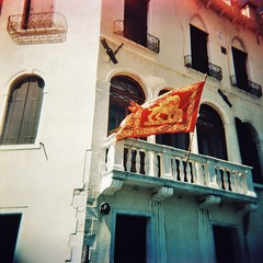 Venician flag (sonofwalrus) Tags: holga film lomo lomography scan venice italy europe italia windows architecture building venezia xpro xprocessing flag