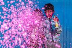 Color Spray (Rajneesh Panwar) Tags: portrait children child india indian pink blue color spray holi nandgaon barsana play water