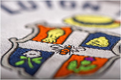 Macro Mondays – Cloth/Textile (Kev Gregory (General)) Tags: clothtextile macromondays polo shirt sporting crest lifelong supported team luton town football club focussed bee white cross wheatsheaf beehive rose thistle straw boater industry renowned hatters agriculture supply local hatting strawplaiting group scots protection sir john napier hoo traditionally emblem hive represents famous arms family symbol scotland national marquess bute formerly owned manor kev gregory canon 7d macro mondays 100 100mm f28 usm ef challenge theme