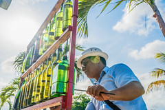 Bottle Player (si_glogiewicz) Tags: wine bottles music musical street musician notes player instrument instruments mexico quintana roo