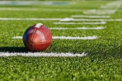 Football on Field (EJC Football) Tags: brown game color field grass lines leather sport closeup corner ball season outside football athletic pain goal team energy close emotion reaching outdoor stadium mark background object empty unity seasonal nopeople hobby hike line number varsity american pile dreams pitch recreation fans cheer win copyspace athletes players lose touchdown marking tackle threads teamwork cowhide pastime tackling tackled grabbing lined drager firstdown thirddown seconddown forthdown