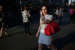 Rockabilly (Gary Kinsman) Tags: london piccadillycircus w1 canon28mmf18 canon5dmkii canoneos5dmarkii candid streetphotography streetlife woman rockabilly fashion style cool redbag earlyevening goldenhour tattoos londonist 2013 people person