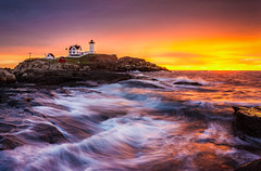 Epic Sunrise at Nubble Lighthouse (BenjaminMWilliamson) Tags: ocean morning sea sky lighthouse seascape motion fall tourism me water colors beautiful clouds composition sunrise canon landscape island photography dawn coast photo scenery rocks colorful waves power image ominous vibrant maine shoreline scenic newengland dramatic rocky vivid wave landmark tourist historic atlantic gifts coastal shore prints coastline attraction nubblelight nubble capeneddick rebelt2i benjaminwilliamson