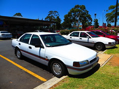 Two 1990s Ford Falcons! (RS 1990) Tags: two white cars ford ed twins elizabeth january s mcdonalds falcon adelaide gli 9th thursday southaustralia 1990s eb identical 2014 sedans