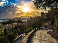 Málaga Skyfire (RobertCross1 (off and on)) Tags: city sunset sea españa sun architecture clouds landscape andalucía spain europe mediterranean cloudy olympus moors málaga omd m43 em5 microfourthirds mygearandme mygearandmepremium mygearandmebronze mygearandmesilver mygearandmegold mygearandmeplatinum 1250mmf3563mzuiko