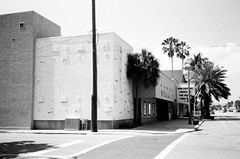 Byron Carlyle Theater (Phillip Pessar) Tags: camera bw white cinema black film beach analog us store theater theatre florida zoom kodak miami district infinity tx trix north places olympus x historic national thrift shore 400 register tri byron 70 carlyle