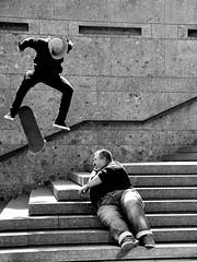 two worlds collide (RadarOReilly) Tags: street people bw stairs germany deutschland blackwhite jump kln menschen treppe skateboard nrw sw sprung stunt stuntman schwarzweis strase