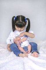 Zooey & Jolene (charlenecasillas) Tags: girls light baby cute love girl sisters pose photography natural baseball small adorable siblings precious tiny newborn barefoot jerseys pigtails dodgers charlenecasillas