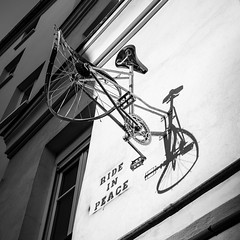 Ride in Peace (McQuaide Photography) Tags: paris france french républiquefrançaise iledefrance europe sony a7rii ilce7rm2 alpha mirrorless 1635mm sonyzeiss zeiss variotessar fullframe mcquaidephotography adobe photoshop lightroom handheld light availablelight city capitalcity urban building blackandwhite bw mono monochrome blackwhite street streetart rideinpeace bike velo bicyclette bicycle ruedesboulangers jussieu urbanart shadow square squarecrop 11 quartiersaintvictor 5earrondissement mur wall