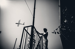 (fancy flight) Tags: boy sky bw black composition contrast dark airplane fly dream compo fancyflight