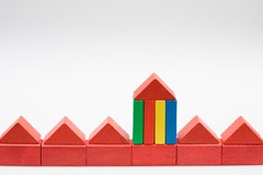 Child's red wooden building block houses in a row --- Image by © RelaXimages/Corbis (erosjeff) Tags: wood red stilllife house color architecture germany toy idea togetherness miniature construction model europe nobody line whitebackground daytime studioshot copyspace conceptual multicolored sequence shape sidebyside contrasts owner conformity dwelling buildingconstruction homeowner buildingblocks centraleurope multipleimages closeupview sizecontrast detachedhouse propertyowner sixobjects