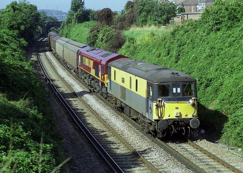 73107 + 66076 work to Hoo Junction with an Enterprise train seen at Gravesend on 28-8-99. Copyright Ian Cuthbertson
