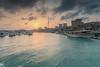 Soog Sharg Marina Sunset - Kuwait (AlkhashabNawaf) Tags: blue light sunset sea seascape colors yellow marina landscape boats fuji fujifilm kuwait soog q8 nawaf غروب الكويت sharg سوق xe1 شرق نواف الخشاب alkhashab