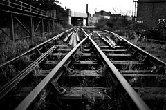 Crossed lines....... (Dafydd Penguin) Tags: city uk railroad england urban bw white black monochrome train 35mm bristol island nikon focus track metro harbour britain floating inner explore spike disused f2 nikkor derelict d600