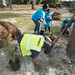 JAXPORT leadership and employees spruce up the port-owned property along the river in Mayport