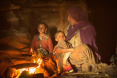 Traditional Coffee Making in Ethiopia (departing(YYZ)) Tags: africa travel family portrait people food woman coffee rural children fire beans women village drink muslim islam traditional young mother ceremony roast indoors stove editorial inside ethiopia simienmountains sonnartfe55mmf18zalens