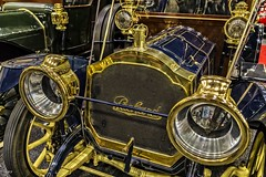 Pristine Packard Decked in Gold (Kool Cats Photography over 8 Million Views) Tags: car gold paint trim vehicle minimalistic closeup carshow oklahomacityautoshow oklahoma antique packard shiny shiney headlamps reflections
