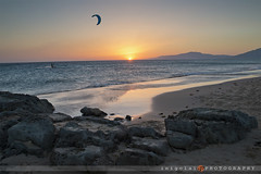 TARIFA/sunset lonely kite (inigolai) Tags: tarifa cadiz andalucia spain landscape sunset water ocean sean colors warm colorful colores color loslancesbeach beach levantewind windy sand kitesurfing kites travel traveler traveling planeta planetearth earth tierra costasur southcoast mar maratlantico tariff theworldoftravel fotoviajero fotoviajeros autumn andalusia beautifullight