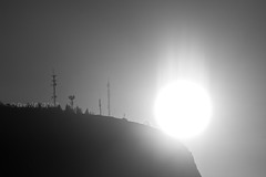 Black Knight Mountain at Sunrise 3 (LongInt57) Tags: sunrise dawn sky mountains radio broadcast towers transmitters silhouettes shining shine rays bw mono black white grey gray nature landscape kelowna bc canada okanagan