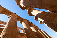 Great hypostyle hall with giant lotus columns (Dima F.) Tags: africa old travel heritage history tourism archaeology monument stone architecture religious temple hall ancient sandstone ruins symbol lotus antique religion egypt culture landmark carving historic nile east national engraving egyptian pharaoh limestone civilization column symbols script karnak luxor vacations mythology ramses engraved hieroglyphs excursion thebes colonnade touristic amon antiquity cartouche amun hieroglyphic
