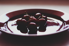 And life is a bowl of cherries (Zaparowana) Tags: light shadow kitchen breakfast canon catchycolors cherry eos 50mm cherries dof purple bokeh violet plate 18 650d 18mp