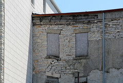 Melting (Pythaglio) Tags: county windows ohio building abandoned phoenix stone facade rear historic commercial limestone erie sagging stucco boarded sandusky collapsing 1849 sills lintels